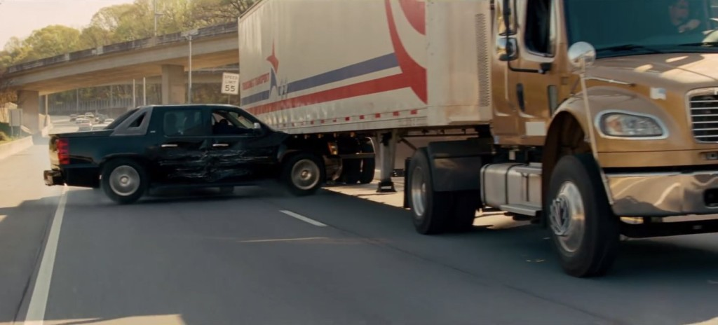 Somehow the black truck gets out of this jam.